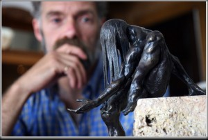 "Tim Holmes with his bronze ""Who Gives All Gifts"""